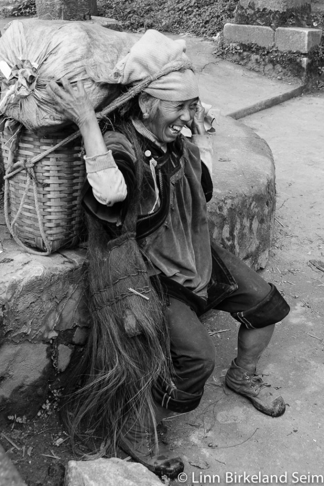 Photo of an old working lady ethnic minority Yunnan