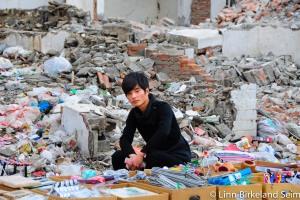 Armani in the rubble