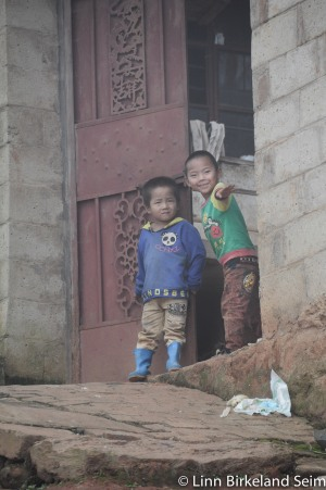 Boys playing in a little village near Dayangjie, Yunnan. China - 2013.