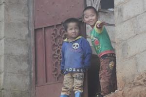 Boys playing in a little village near Dayangjie, Yunnan. China - 2013.