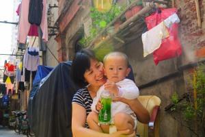 Living life on the streets. Shanghai, China - 2013. Dongsiwenli, shikumen