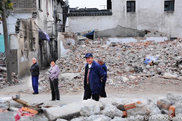 Their neighbourhood is being demolished. Suzhou, China - 2012.